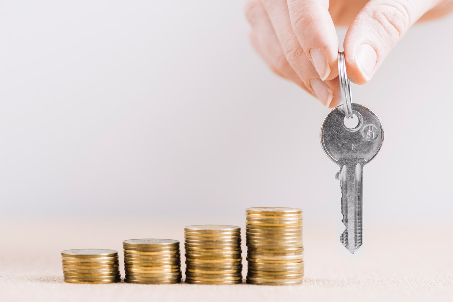 coins and key to house