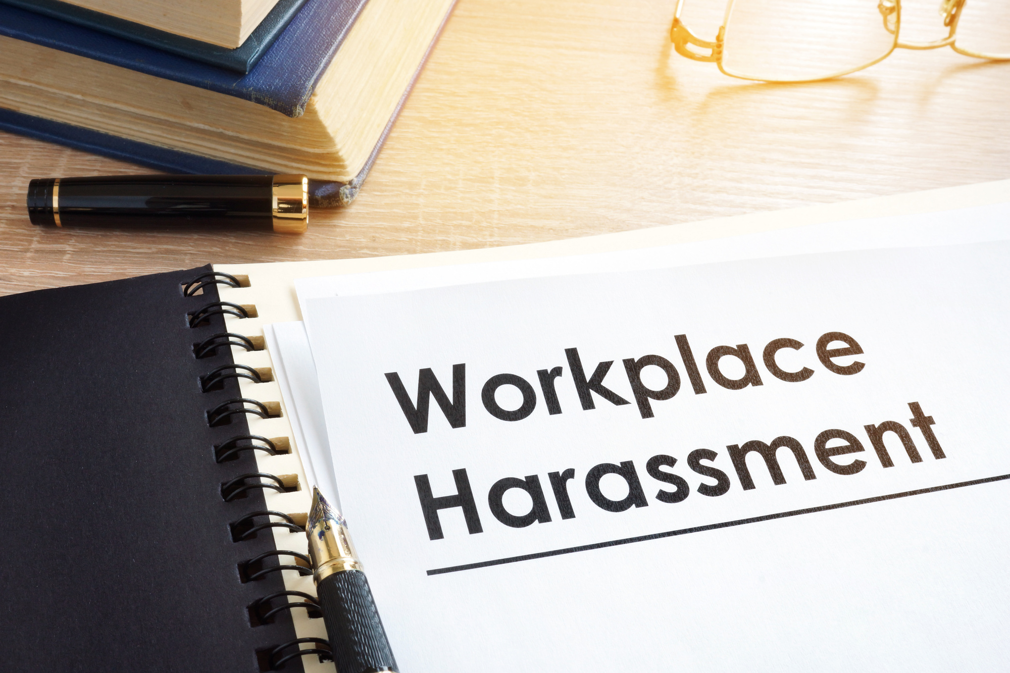 Documents about workplace harassment in an office.