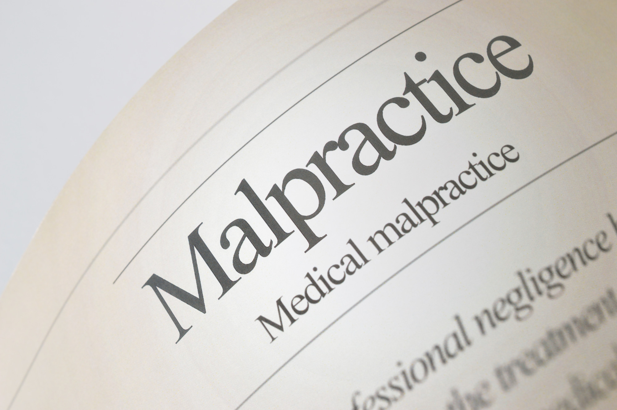 page on a book with a title maplractice medical insurnace