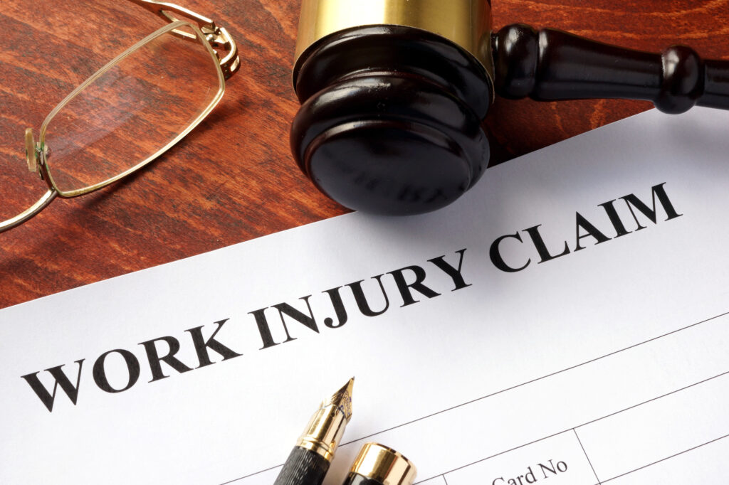 work injury claim papers on top of a judges table