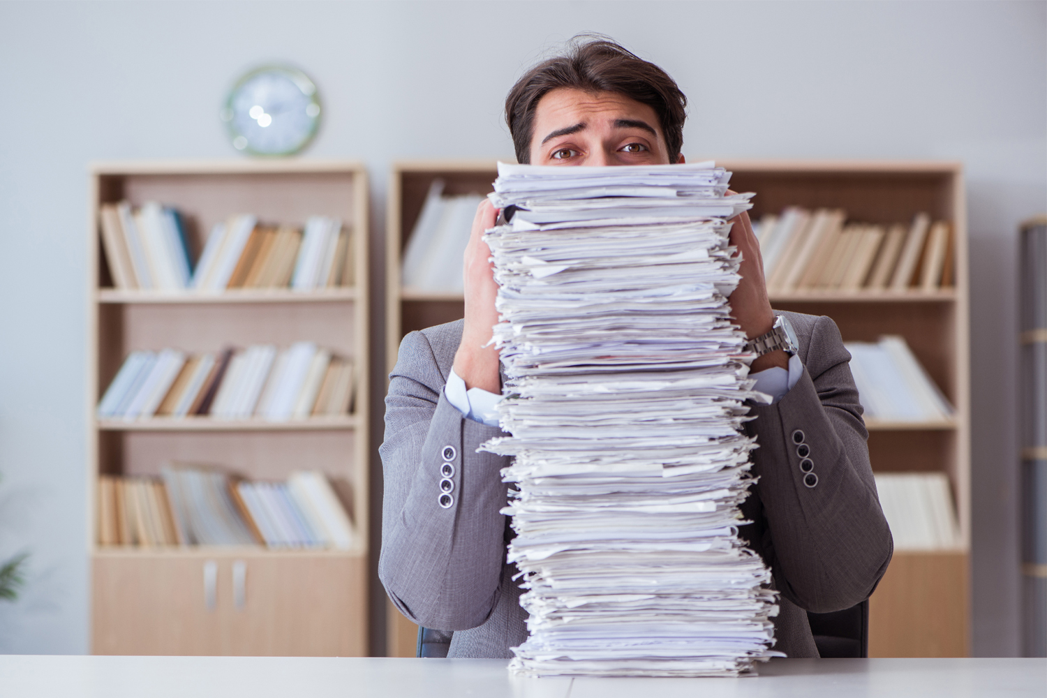 Employee having issues with stack of paper