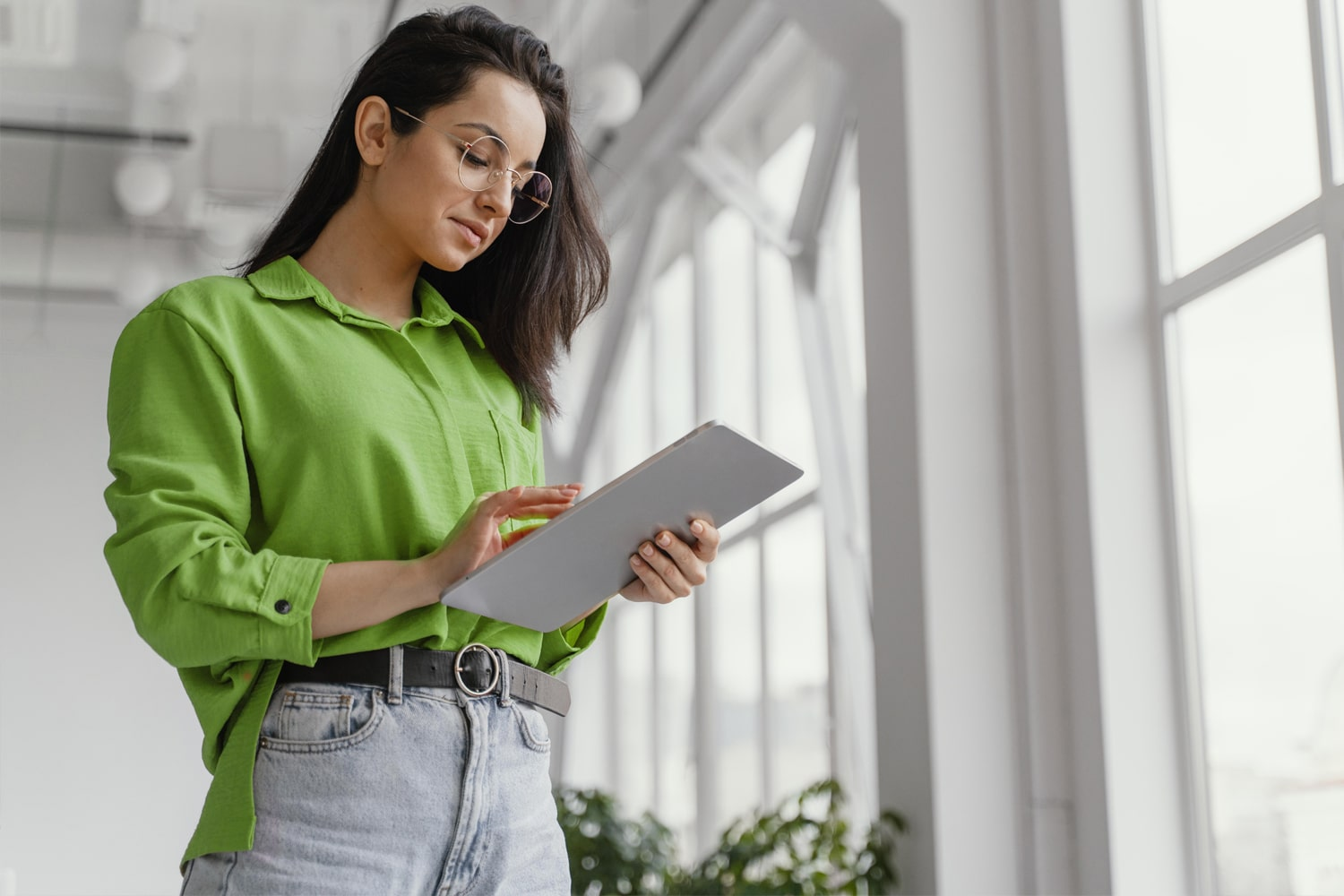 woman checking her ipad for information
