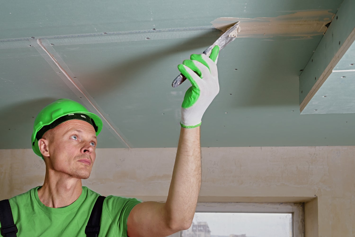 Man fixing ceiling