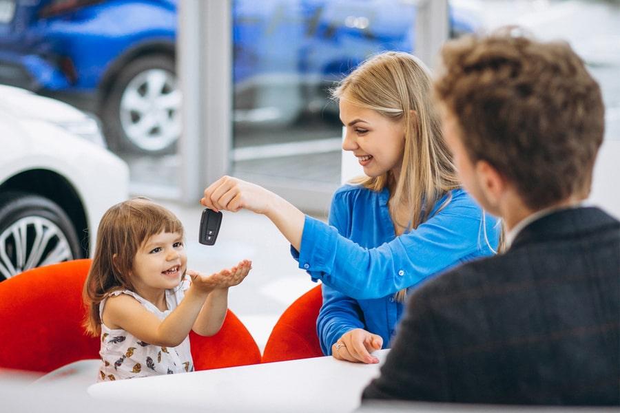 Mom handing car key to kid