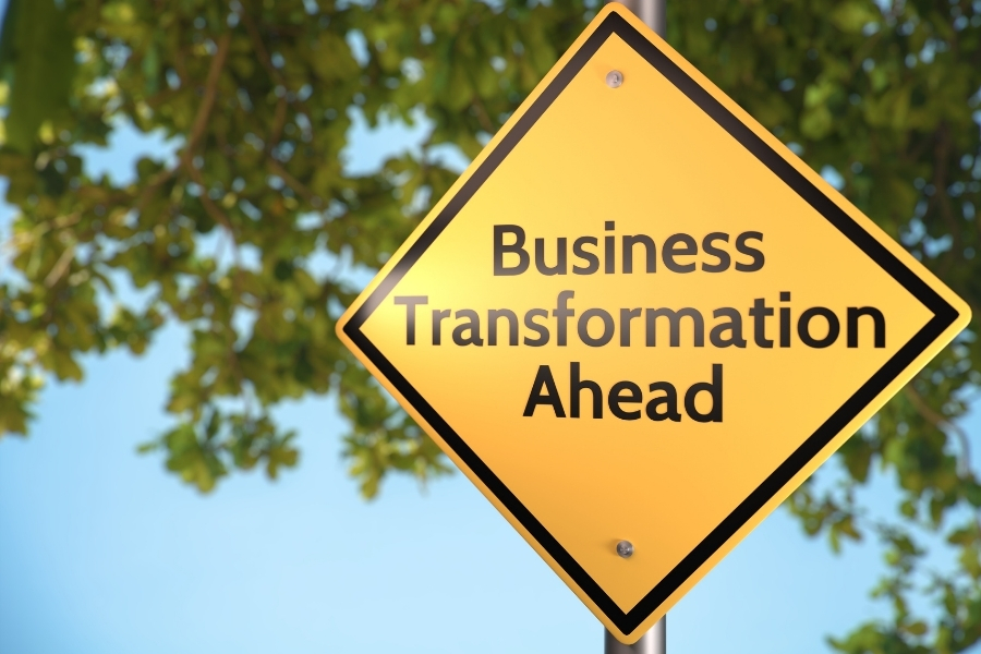 "signage with ""business transformation ahead"" written on it"