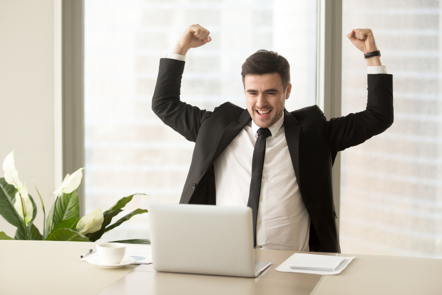 Businessman excited because of achievement in business