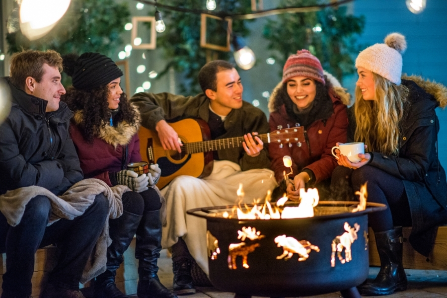 group of friends jamming, bonfire on a winter night