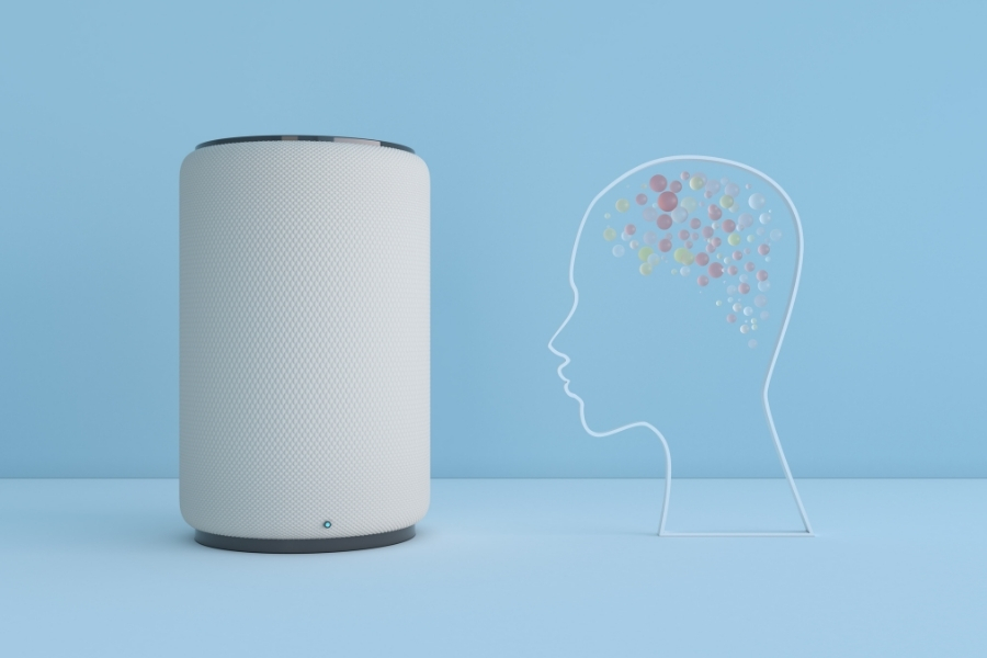 smart assistant device next to a decoration of human brain gem